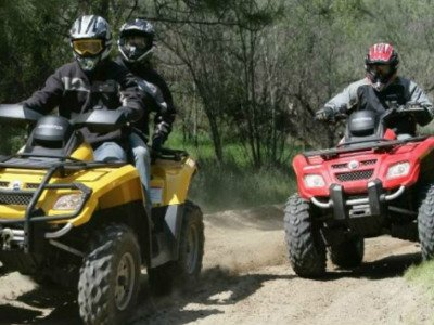 Photo of people riding ATV's