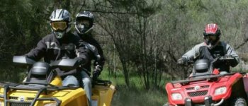 Photo of Two People Riding ATV's